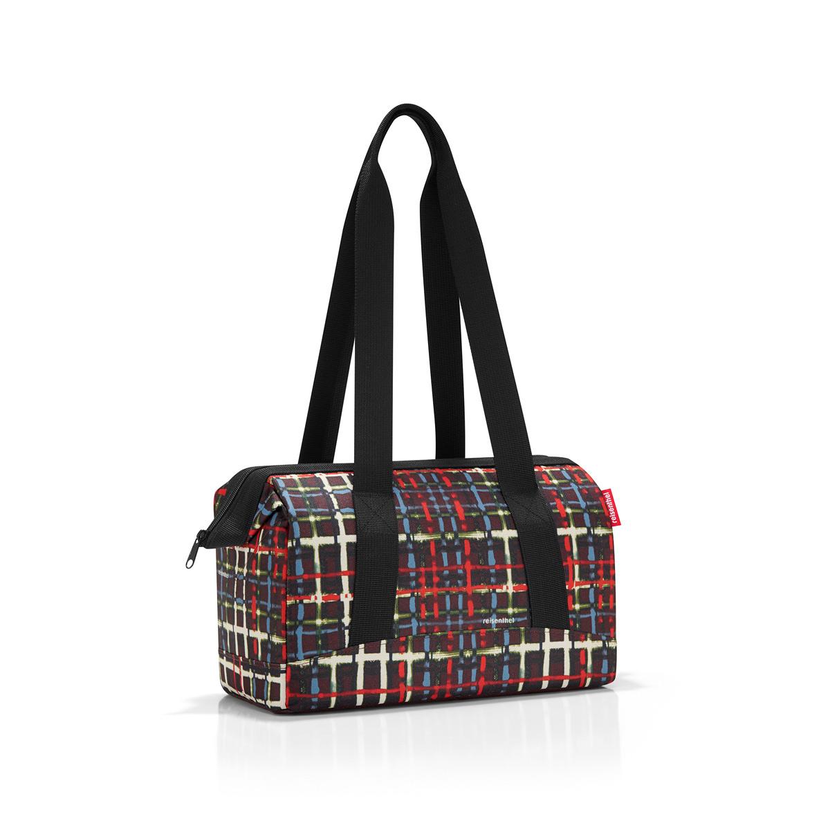 Сумка Reisenthel, цвет: черный, красный, синий. MR7036MR7036Вместительная сумка Reisenthel изготовлена из текстиля с оригинальным принтом. Сумка имеет одно отделение, которое закрывается на застежку-молнию. Внутри расположены шесть накладных карманов, два из которых на резинке. В изделие встроены металлические скобы, фиксирующие его в открытом положении. Сумка оснащена двумя длинными ручками, позволяющими носить изделие на плече.