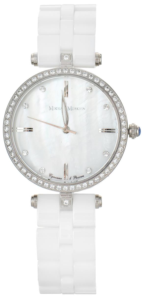 Часы наручные женские Mikhail Moskvin Elegance, цвет: белый, серебряный. 1195S16B11195S16B1Стильные женские наручные часы Mikhail Moskvin из серии Elegance изготовлены из высокотехнологичной гипоаллергенной нержавеющей стали и дополнены изящным керамическим браслетом. Для того чтобы защитить циферблат от повреждений в часах используется высокопрочное стекло с сапфировым напылением. Тонкий ободок из сверкающих стразов обрамляет перламутровый циферблат. На перламутровой поверхности на месте индикации часов чередуются прямоугольные двойные знаки и круглые вставки - цирконы. Высокоточный японский кварцевый механизм производства фирмы Miyota Sitizen оснащен часовой, минутной и секундной стрелками. Стальные заостренные стрелки заполнены белой массой. Граненая заводная головка венчается блестящей сферой. Циферблат изделия оформлен символикой бренда. Браслет часов застегивается на замок-бабочку, который позволит с легкостью снимать и надевать часы. Часы упакованы в фирменную коробку с прозрачным окошком и дополнительно в текстильную сумку с названием бренда. Часы...