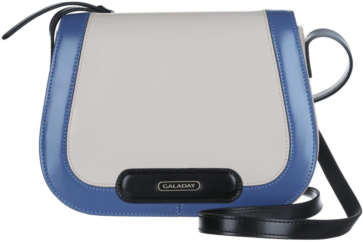 Сумка женская Galaday, цвет: бежевый, синий, черный. GD4727GD4727Стильная женская сумка жесткой конструкции Galaday выполнена из натуральной гладкой кожи, оформлена оригинальным сочетанием цветов и металлической пластиной логотипа бренда. Изделие состоит из одного отделения, закрывающегося на застежку-молнию и дополнительно клапаном на магнитную кнопку. Отделение содержит карман-средник на молнии, два нашивных кармана для телефона и мелочей и один врезной карман на молнии. На тыльной стороне расположен врезной карман на молнии. Сумка оснащена несъемным плечевым ремнем, регулируемой длины. Прилагается фирменный текстильный чехол для хранения изделия. Сумка Galaday внесет элегантные нотки в ваш образ и подчеркнет ваше отменное чувство стиля.