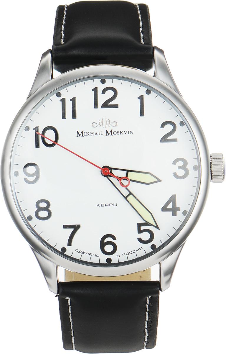 Часы наручные мужские Mikhail Moskvin, цвет: черный, серебристый. 1204A1L31204A1L3Стильные мужские наручные часы Mikhail Moskvin изготовлены из высокотехнологичной гипоаллергенной нержавеющей стали и дополнены ремешком из искусственной кожи. Ремешок оформлен контрастной отстрочкой и тиснением логотипа бренда с внутренней стороны. Для того чтобы защитить циферблат от повреждений в часах используется высокопрочное минеральное стекло. Чистота линий, нарочитая простота стиля и классический дизайн создают элегантный образ этой модели. Корпус традиционной формы покрыт высоколегированной сталью методом напыления ионами по современным технологиям. На белом поле циферблата контрастные черные часовые индексы в виде арабских цифр и минутная дорожка обеспечивают отличную считываемость. Широкие черные стрелки заполнены люминесцирующей массой. Стильный штрих - красная секундная стрелка. Высокоточный японский кварцевый механизм, производства фирмы Seiko Epson отвечает за работу часовой, минутной и секундной стрелок. Браслет комплектуется надежной и удобной в...