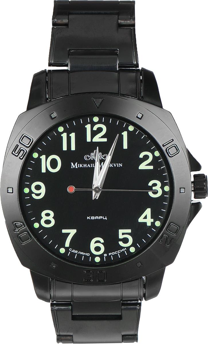 Часы наручные мужские Mikhail Moskvin, цвет: черный. 1125A11B51125A11B5Стильные мужские наручные часы спортивного стиля Mikhail Moskvin изготовлены из высокотехнологичной гипоаллергенной нержавеющей стали и дополнены ремешком из полированной стали. Для того чтобы защитить циферблат от повреждений в часах используется высокопрочное минеральное стекло. Крупный корпус с широким браслетом укомплектован надежным, высокоточным японским кварцевым механизмом, производства фирмы Seiko Epson. Черное покрытие высокого качества выполнено по современным технологиям ионного напыления и придает стойкость к коррозии. Чтобы подчеркнуть спортивный характер модели на круглом безеле расположены крупные индексы - обозначение минутных показателей в виде арабских цифр и квадратных знаков. Черный циферблат служит контрастным фоном для контрастных арабских цифр, минутной дорожки и серебристых заостренных стрелок с люминесцентным заполнением. Браслет комплектуется надежной и удобной в использовании застежкой-клипсой, которая позволит с легкостью снимать и надевать часы....