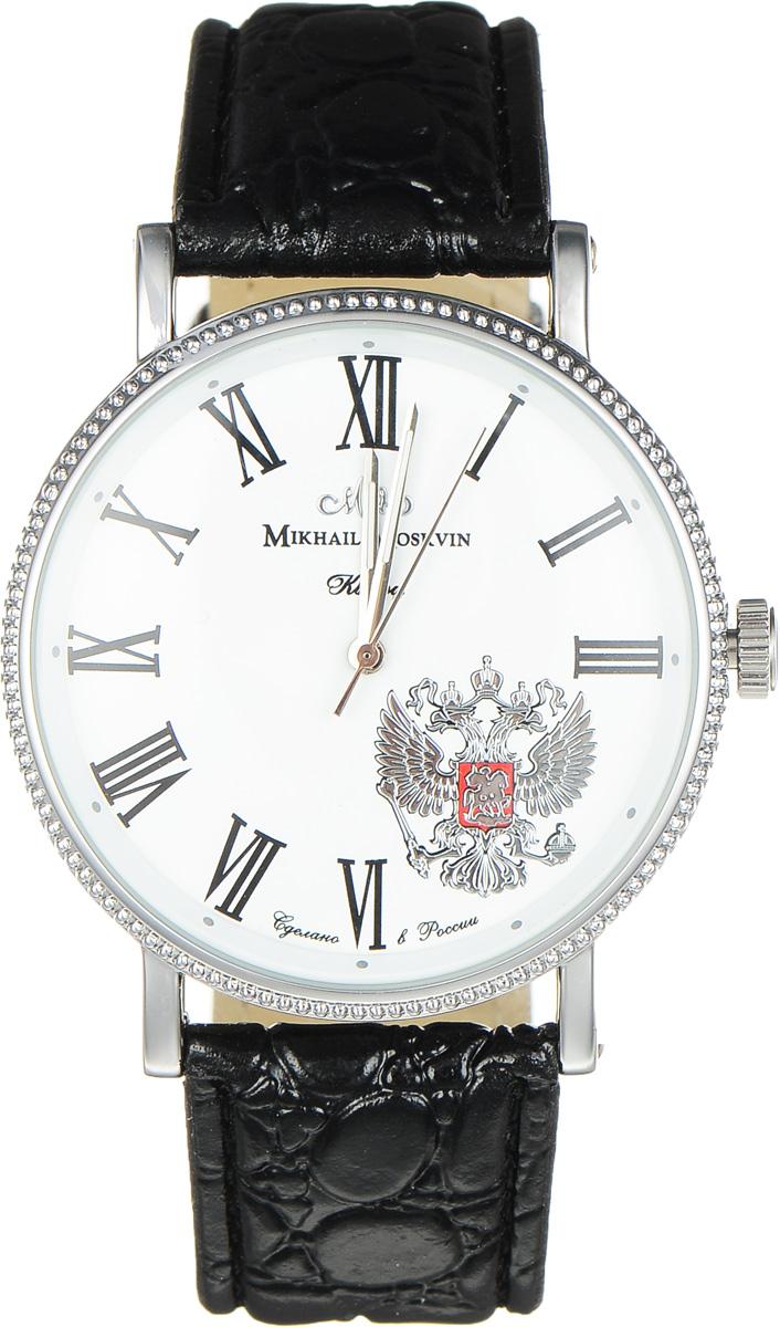 Часы наручные мужские Mikhail Moskvin, цвет: черный, серебристый. 1128A1L11128A1L1Стильные мужские наручные часы Mikhail Moskvin изготовлены из высокотехнологичной гипоаллергенной нержавеющей стали и дополнены ремешком из искусственной кожи. Для того чтобы защитить циферблат от повреждений в часах используется высокопрочное минеральное стекло. Тонкие скругленные уши, фиксирующие черный ремень, стилизованный под кожу крокодила, дополнены с боков винтами. Черные римские цифры на белом поле циферблата и скошенная к центру рамка с круглыми часовыми индексами придают часам стильность. Серебристый герб - символ России - отлично гармонирует с тонкими стальными стрелками. Высокоточный японский кварцевый механизм, производства фирмы Seiko Epson, отвечает за работу часовой, минутной и секундной стрелок и обладает степенью влагозащиты равной 3 Bar. Эта великолепная модель часов сочетает в себе элегантность и надежность. Браслет комплектуется надежной и удобной в использовании застежкой-пряжкой, которая позволит с легкостью снимать и надевать часы, а также регулировать...