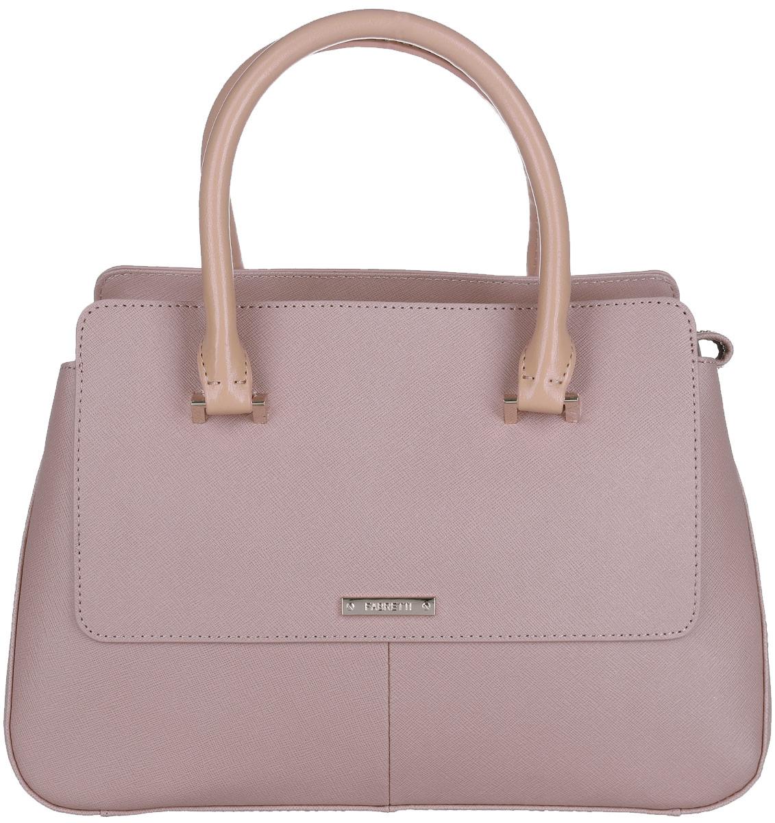 Сумка женская Fabretti, цвет: бежевый, серо-розовый. N2554N2554-beigeСтильная женская сумка Fabretti выполнена из натуральной кожи с фактурным тиснением. Изделие содержит одно вместительное отделение, которое закрывается на застежку-молнию. Внутри расположено два накладных кармашка для мелочей, карман-средник на застежке-молнии и два врезных кармана на молнии. Снаружи, на задней стороне сумки, расположен врезной карман на застежке-молнии. Сумка оснащена удобными ручками и съемным плечевым ремнем, который можно регулировать по длине. Дно сумки оснащено металлическими ножками. Оригинальный аксессуар позволит вам завершить образ и быть неотразимой.