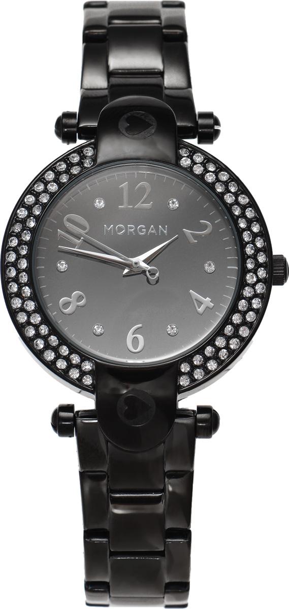 Часы наручные женские Morgan, цвет: черный. M1156BMM1156BMЭлегантные часы Morgan выполнены из стали с IP-покрытием, инкрустированы сияющими чешскими кристаллами и оформлены символикой бренда. Лаконичный корпус с зеркальным циферблатом надежно защищен устойчивым к царапинам минеральным стеклом, а также имеет степень влагозащиты 3 Bar. Часы оснащены кварцевым механизмом, дополнены изящным браслетом, который застегивается на замок-клипсу. Изделие поставляется в фирменной упаковке. Часы Morgan подчеркнут изящество женской руки и отменное чувство стиля у их обладательницы.