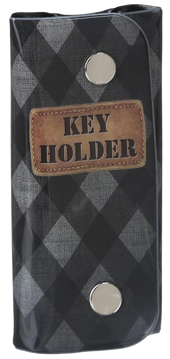 Ключница Magic Home Ромбики, цвет: черный, серый. 4104641046Стильная ключница Magic Home Ромбики изготовлена из ПВХ и имеет одно отделение, закрывающееся при помощи клапана на две кнопки. Внутри имеется одно кольцо для хранения ключей. Ключница оформлена оригинальным принтом в виде ромбов и надписи Key Holder. Этот аксессуар станет замечательным подарком человеку, ценящему качественные и практичные вещи.