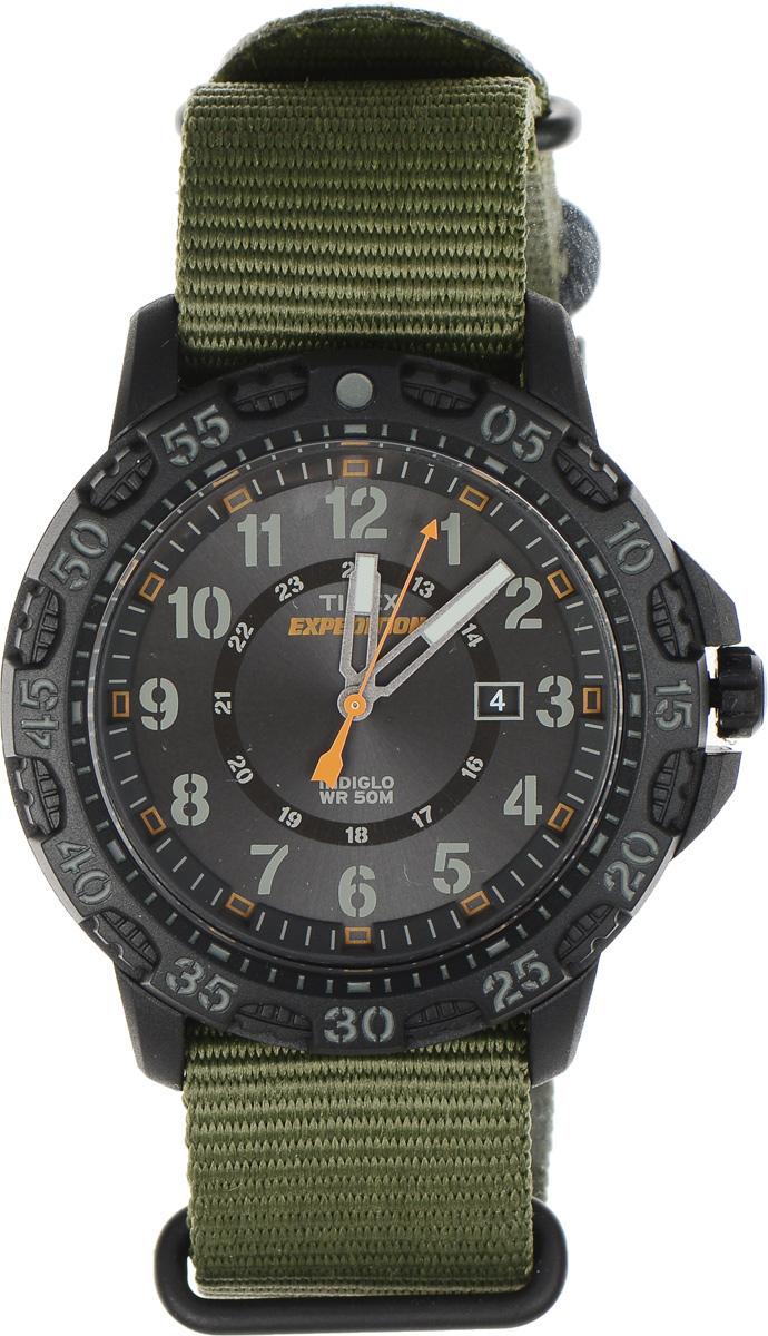 Часы наручные мужские Timex Analog Elevated, цвет: хаки. TW4B03600TW4B03600Стильные часы Timex Analog Elevated выполнены из нержавеющей стали и минерального стекла. Циферблат оснащен запатентованной электролюминесцентной подсветкой INDIGLO, индикатором даты и оформлен символикой бренда. Корпус изделия имеет степень влагозащиты 5 Bar, оснащен кварцевым механизмом и дополнен устойчивым к царапинам минеральным стеклом. Ремешок современного дизайна выполнен из нейлона и оснащен пряжкой, которая позволит с легкостью снимать и надевать изделие. Часы поставляются в фирменной упаковке. Часы Timex Expedition подчеркнут мужской характер и отменное чувство стиля их обладателя.