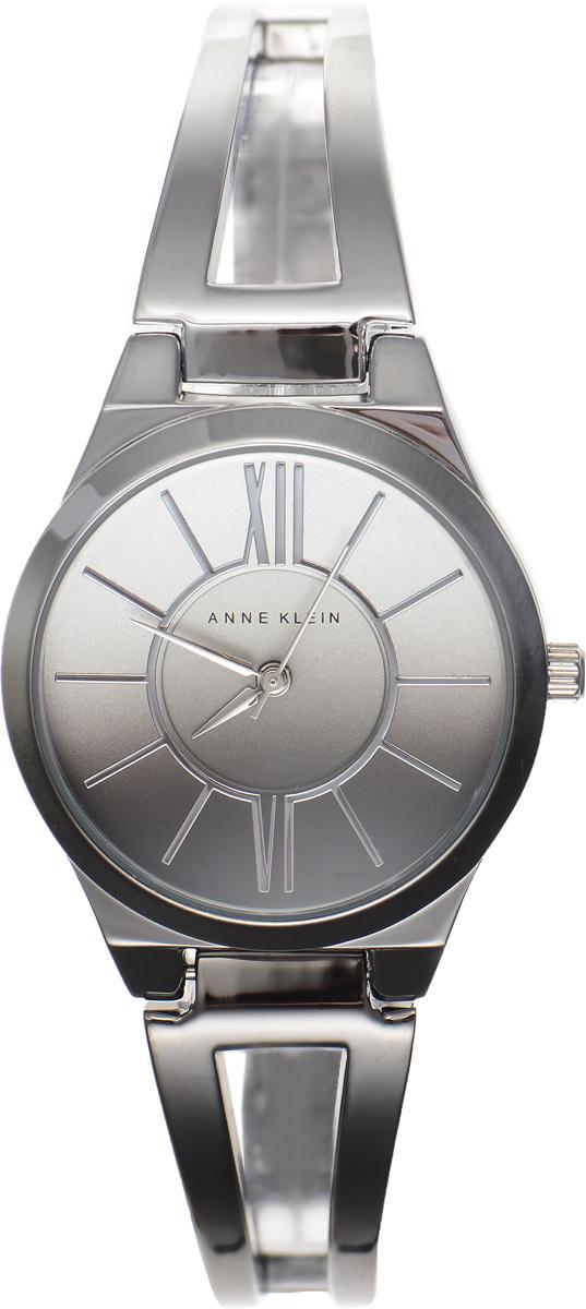 Часы наручные женские Anne Klein Ring, цвет: серебристый. 21532153 OMGYСтильные женские часы Anne Klein Ring с эффектом градиента выполнены из металлического сплава, оформлены символикой бренда. Лаконичный корпус надежно защищен устойчивым к царапинам минеральным стеклом, а также имеет степень влагозащиты 3 Bar. Часы оснащены кварцевым механизмом, дополнены изящным браслетом со складным замком. В конструкции застежки предусмотрено дополнительное звено, благодаря которому возможно регулировать длину изделия. Часы поставляются в фирменной упаковке. Часы Anne Klein Ring подчеркнут изящество женской руки и отменное чувство стиля у их обладательницы.