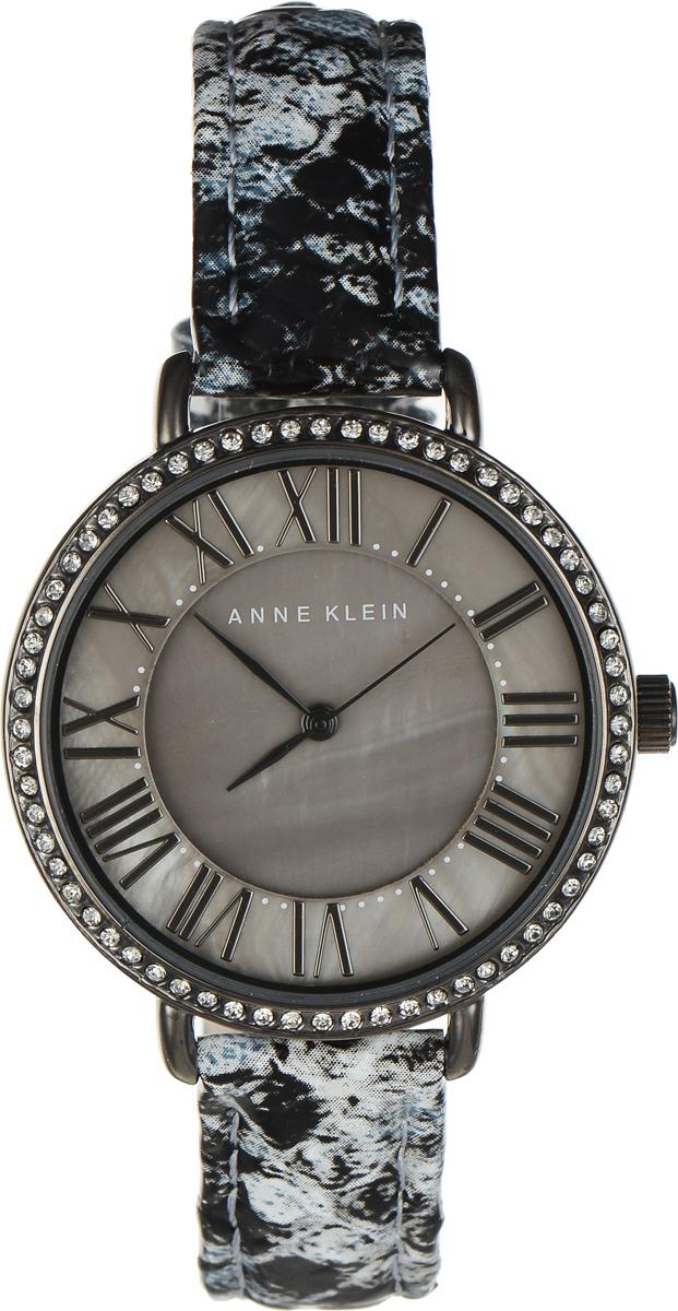 Часы наручные женские Anne Klein Ring, цвет: серый. 16171617 GMGYЭлегантные женские часы Anne Klein Ring выполнены из металлического сплава, оформлены чешскими кристаллами и символикой бренда. Циферблат украшен вставкой из натурального перламутра. Лаконичный корпус надежно защищен устойчивым к царапинам минеральным стеклом, а также имеет степень влагозащиты 3 Bar. Часы оснащены кварцевым механизмом, дополнены изящным ремешком из натуральной кожи с декоративным тиснением под кожу рептилии. Ремешок застегивается на практичную пряжку. Часы поставляются в фирменной упаковке. Часы Anne Klein Ring подчеркнут изящество женской руки и отменное чувство стиля у их обладательницы.