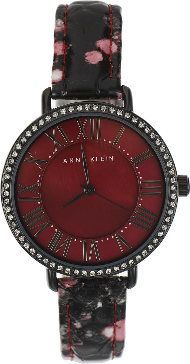 Часы наручные женские Anne Klein Ring, цвет: красный. 16171617 BMBYЭлегантные женские часы Anne Klein Ring выполнены из металлического сплава, оформлены чешскими кристаллами и символикой бренда. Циферблат украшен вставкой из натурального перламутра. Лаконичный корпус надежно защищен устойчивым к царапинам минеральным стеклом, а также имеет степень влагозащиты 3 Bar. Часы оснащены кварцевым механизмом, дополнены изящным ремешком из натуральной кожи с декоративным тиснением под кожу рептилии. Ремешок застегивается на практичную пряжку. Часы поставляются в фирменной упаковке. Часы Anne Klein Ring подчеркнут изящество женской руки и отменное чувство стиля у их обладательницы.
