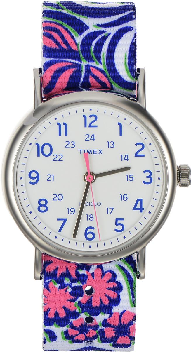 Часы наручные женские Timex Weekender, цвет: фиолетовый, белый. TW2P90200TW2P90200Стильные часы Timex Weekender - это модный и практичный аксессуар, который не только выгодно дополнит ваш наряд, но и будет незаменим для каждой современной девушки, ценящей свое время. Корпус с минеральным стеклом выполнен из латуни и оснащен задней крышкой из нержавеющей стали. Циферблат оснащен запатентованной электролюминесцентной подсветкой Indiglo и оформлен символикой бренда. Корпус изделия имеет степень влагозащиты 3 Bar, оснащен кварцевым механизмом и дополнен устойчивым к царапинам минеральным стеклом. Двусторонний ремешок cо стильным цветочным принтом выполнен из нейлона и дополнен пряжкой, которая позволяет с легкостью снимать и надевать изделие. Часы поставляются в фирменной упаковке. Часы Timex подчеркнут изящество ваших рук, а также ваш неповторимый стиль.