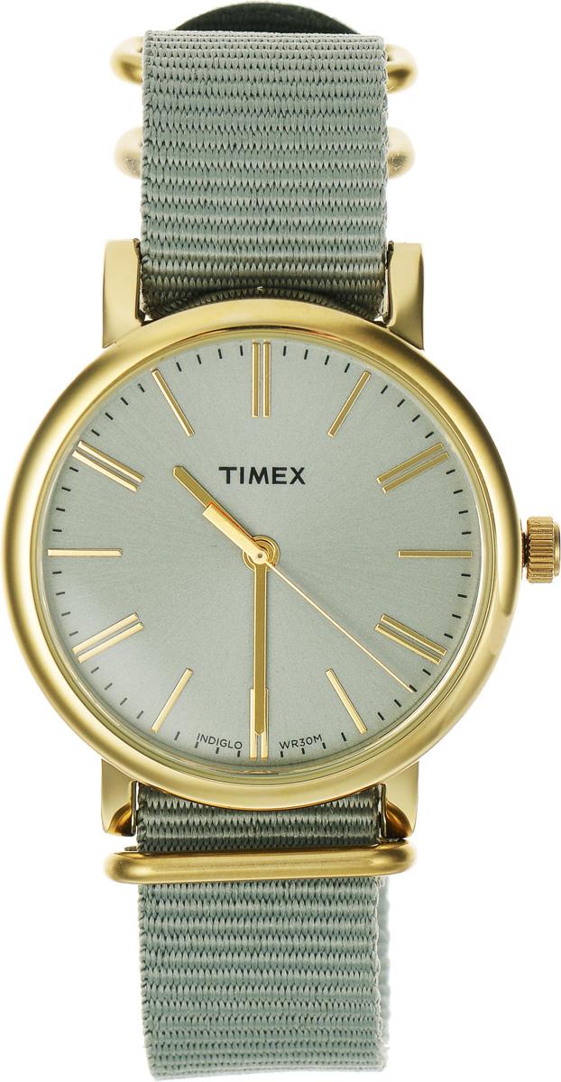 Часы наручные женские Timex Originals, цвет: золотой, оливковый. TW2P88500TW2P88500Стильные часы Timex Originals выполнены из нержавеющей стали и минерального стекла. Циферблат оснащен запатентованной электролюминесцентной подсветкой INDIGLO и оформлен символикой бренда. Корпус изделия имеет степень влагозащиты 3 Bar, оснащен кварцевым механизмом и дополнен устойчивым к царапинам минеральным стеклом. Ремешок современного дизайна выполнен из нейлона и оснащен пряжкой, которая позволит с легкостью снимать и надевать изделие. Часы поставляются в фирменной упаковке. Часы Timex Originals подчеркнут изящество женской руки и отменное чувство стиля у их обладательницы.