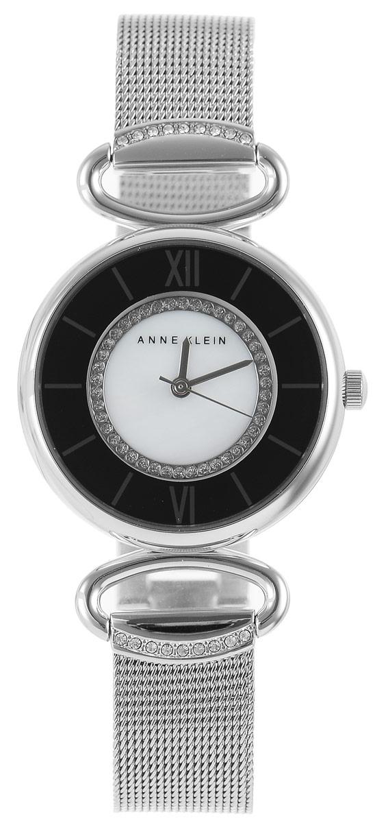 Часы наручные женские Anne Klein Ring, цвет: серебристый. 21512151 MPSVЭлегантные женские часы Anne Klein Ring выполнены из металлического сплава, оформлены кристаллами Swarovski и символикой бренда. Циферблат часов украшен перламутровой вставкой. Лаконичный корпус надежно защищен устойчивым к царапинам минеральным стеклом, а также имеет степень влагозащиты 3 Bar. Часы оснащены кварцевым механизмом, дополнены изящным браслетом со складным замком. В конструкции застежки предусмотрено дополнительное звено, благодаря которому возможно регулировать длину изделия. Часы поставляются в фирменной упаковке. Часы Anne Klein Ring подчеркнут изящество женской руки и отменное чувство стиля у их обладательницы.