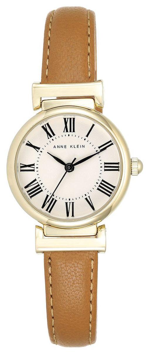 Часы наручные женские Anne Klein Daily, цвет: золотистый, светло-коричневый. 22462246 CRHYЭлегантные женские часы Anne Klein Daily выполнены из металлического сплава, оформлены символикой бренда. Лаконичный корпус надежно защищен устойчивым к царапинам минеральным стеклом, а также имеет степень влагозащиты 3 Bar. Часы оснащены кварцевым механизмом, дополнены изящным ремешком из натуральной кожи. Ремешок застегивается на практичную пряжку. Часы поставляются в фирменной упаковке. Часы Anne Klein Daily подчеркнут изящество женской руки и отменное чувство стиля у их обладательницы.