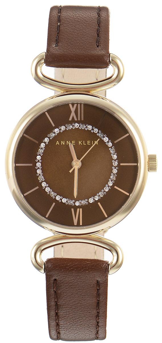 Часы наручные женские Anne Klein Ring, цвет: коричневый, золотой. 19321932 BMBNЭлегантные женские часы Anne Klein Ring выполнены из металлического сплава, оформлены чешскими кристаллами и символикой бренда. Циферблат украшен вставкой из натурального перламутра. Лаконичный корпус надежно защищен устойчивым к царапинам минеральным стеклом, а также имеет степень влагозащиты 3 Bar. Часы оснащены кварцевым механизмом, дополнены изящным ремешком из натуральной кожи. Ремешок застегивается на практичную пряжку. Часы поставляются в фирменной упаковке. Часы Anne Klein Ring подчеркнут изящество женской руки и отменное чувство стиля у их обладательницы.