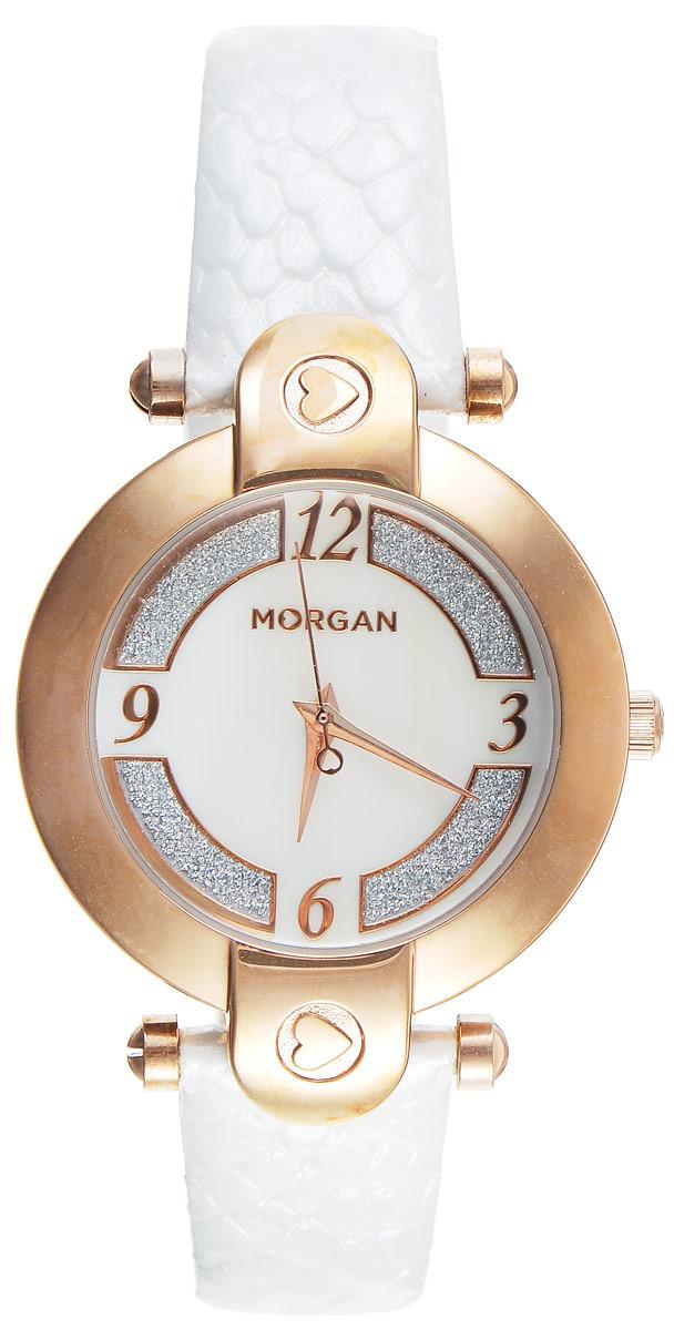 Часы наручные женские Morgan, цвет: золотой, белый. M1134WRGBRM1134WRGBRЭлегантные часы Morgan выполнены из нержавеющей стали и минерального стекла. Циферблат оформлен блестками и символикой бренда. Корпус изделия имеет степень влагозащиты 3 Bar, оснащен кварцевым механизмом и дополнен устойчивым к царапинам минеральным стеклом. Ремешок современного дизайна выполнен из натуральной кожи с декоративным тиснением под кожу рептилии и оснащен пряжкой, которая позволит с легкостью снимать и надевать изделие. Часы поставляются в фирменной упаковке. Часы Morgan подчеркнут изящество женской руки и отменное чувство стиля у их обладательницы.