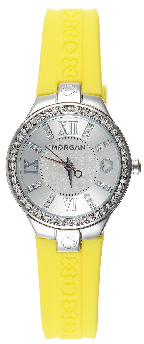 Часы наручные женские Morgan, цвет: стальной, желтый. M1138YBRM1138YBRОригинальные часы Morgan выполнены из стали, оформлены символикой бренда и инкрустированы чешскими кристаллами. Лаконичный корпус часов надежно защищен устойчивым к царапинам минеральным стеклом. Часы оснащены кварцевым механизмом, дополнены ремешком из силикона, который застегивается на практичную пряжку. Изделие поставляется в фирменной упаковке. Часы Morgan подчеркнут изящество женской руки и отменное чувство стиля у их обладательницы.