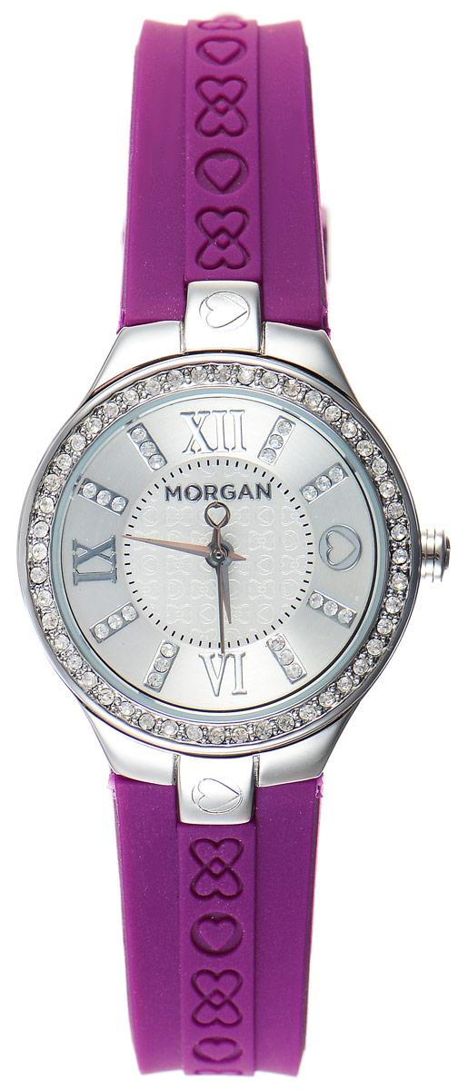 Часы наручные женские Morgan, цвет: стальной, фиолетовый. M1138VBRM1138VBRОригинальные часы Morgan выполнены из стали, оформлены символикой бренда и инкрустированы чешскими кристаллами. Лаконичный корпус часов надежно защищен устойчивым к царапинам минеральным стеклом. Часы оснащены кварцевым механизмом, дополнены ремешком из силикона, который застегивается на практичную пряжку. Изделие поставляется в фирменной упаковке. Часы Morgan подчеркнут изящество женской руки и отменное чувство стиля у их обладательницы.