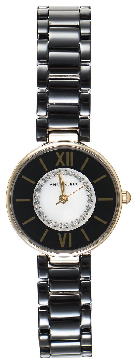 Часы наручные женские Anne Klein Ceramics, цвет: золотой, черный. 2178 BKGB2178 BKGBЭлегантные женские часы Anne Klein Ceramics выполнены из металлического сплава, оформлены кристаллами Swarovski и символикой бренда. Циферблат часов украшен перламутровой вставкой. Лаконичный корпус надежно защищен устойчивым к царапинам минеральным стеклом. Часы оснащены кварцевым механизмом, дополнены изящным браслетом со складным замком. В конструкции застежки предусмотрено дополнительное звено, благодаря которому возможно регулировать длину изделия. Часы поставляются в фирменной упаковке. Часы Anne Klein Ceramics подчеркнут изящество женской руки и отменное чувство стиля у их обладательницы.