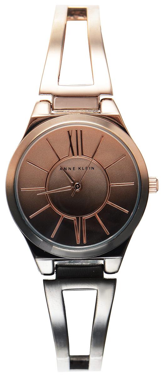 Часы наручные женские Anne Klein Ring, цвет: черный, золотистый. 2152 OMRG2152 OMRGСтильные женские часы Anne Klein Ring с эффектом градиента выполнены из металлического сплава, оформлены символикой бренда. Лаконичный корпус надежно защищен устойчивым к царапинам минеральным стеклом, а также имеет степень влагозащиты 3 Bar. Часы оснащены кварцевым механизмом, дополнены изящным браслетом со складным замком. В конструкции застежки предусмотрено дополнительное звено, благодаря которому возможно регулировать длину изделия. Часы поставляются в фирменной упаковке. Часы Anne Klein Ring подчеркнут изящество женской руки и отменное чувство стиля у их обладательницы.