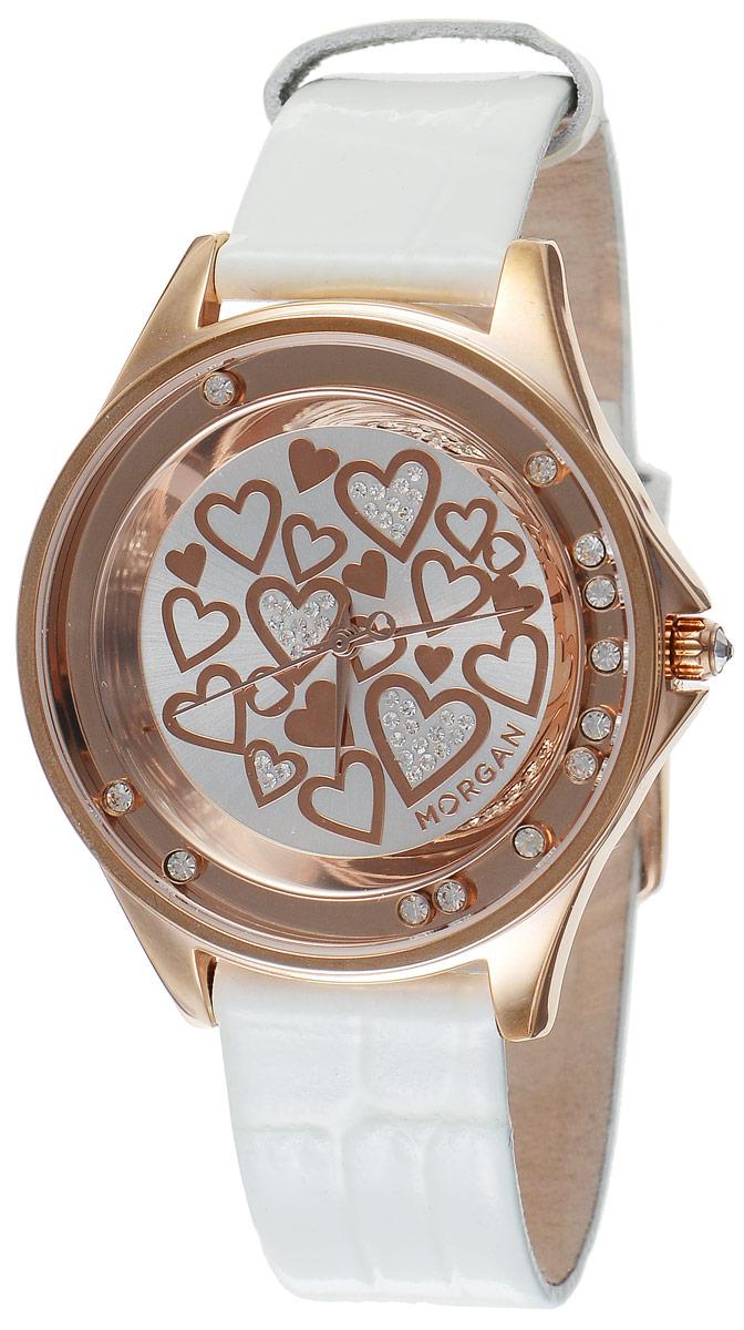 Часы наручные женские Morgan, цвет: золотой, белый. M1136WRGBRM1136WRGBRЭлегантные часы Morgan выполнены из стали с IP-покрытием, оформлены символикой бренда и инкрустированы чешскими кристаллами. Лаконичный корпус часов дополнен плавающими по окружности кристаллами, а также надежно защищен устойчивым к царапинам минеральным стеклом. Часы оснащены кварцевым механизмом, дополнены кожаным ремешком с лаковым покрытием и декоративным тиснением под кожу рептилии. Ремешок застегивается на практичную пряжку. Изделие поставляется в фирменной упаковке. Часы Morgan подчеркнут изящество женской руки и отменное чувство стиля у их обладательницы.