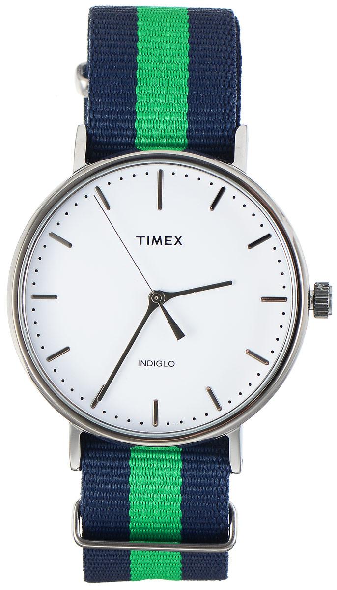 Часы наручные мужские Timex Weekender, цвет: темно-синий, зеленый. TW2P90800TW2P90800Стильные мужские часы Timex Weekender - это модный и практичный аксессуар, который не только выгодно дополнит ваш образ, но и будет незаменим для каждого современного мужчины, ценящего свое время. Корпус с минеральным стеклом выполнен из латуни и оснащен задней крышкой из нержавеющей стали. Циферблат оснащен запатентованной электролюминесцентной подсветкой Indiglo и оформлен символикой бренда. Корпус изделия имеет степень влагозащиты 3 Bar, оснащен кварцевым механизмом и дополнен устойчивым к царапинам минеральным стеклом. Ремешок cо стильным принтом в полоску выполнен из нейлона и дополнен пряжкой, которая позволяет с легкостью снимать и надевать изделие. Часы поставляются в фирменной упаковке. Часы Timex подчеркнут ваш неповторимый стиль и дополнят любой наряд.
