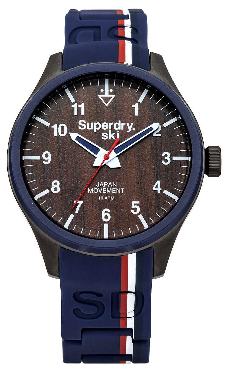 Часы наручные Superdry Urban, цвет: синий. SYG185USYG185UСтильные часы Superdry Urban выполнены из нержавеющей стали, пластика и хезалитового стекла. Циферблат оформлен символикой бренда. Корпус изделия имеет степень влагозащиты 10 Bar, оснащен кварцевым механизмом и дополнен устойчивым к царапинам хезалитовым стеклом. Ремешок современного дизайна выполнен из силикона и оснащен клипсовым замком, который позволит с легкостью снимать и надевать изделие. Часы поставляются в фирменной упаковке. Часы Superdry Urban подчеркнут отменное чувство стиля их обладателя.