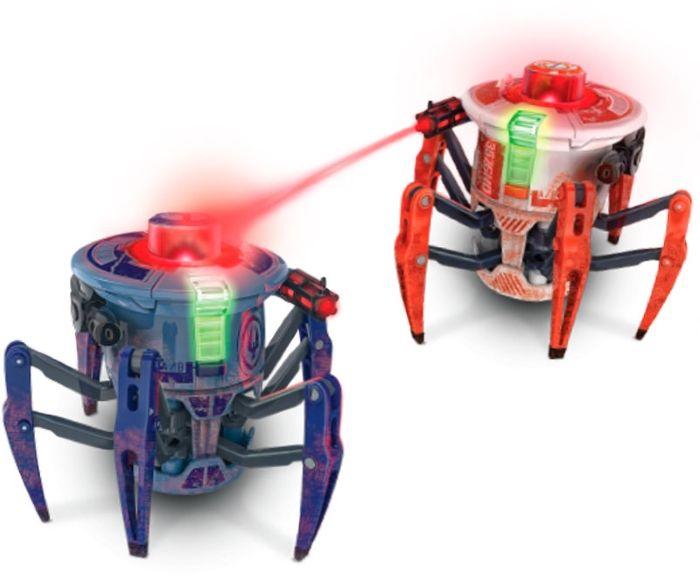 Hexbug Набор из двух Боевых Спайдеров на радиоуправлении477-3598Боевой спайдер быстро бегает и разворачивается на 360 градусов, стоя на месте. Полностью контролировать его действия можно с помощью пульта управления. Кроме своего совершенно фантастического внешнего вида, в котором сочетается природные формы настоящего паука, этот спайдер оснащен специальными лазерными пушками по бокам, которые и должны поражать соперника. Красный светодиодный глаз всегда показывает направление взгляда микроробота, а боковые лазерные турели готовы к бою. Как только противник появится в поле зрения и нажав кнопку выстрела на пульте управления, пушка робота посылает лазерный луч в направлении соперника. Этот выстрел принимается зеркалами, что установлены на крышке каждого паука. После попадания противник загорается красным светом и отскакивает, а его пульт управления вибрирует. После десяти точных попаданий робот автоматически отключается, признавая, таким образом, свое поражение. Встроенные динамики во время каждого выстрела сопровождают бой устрашающими и...