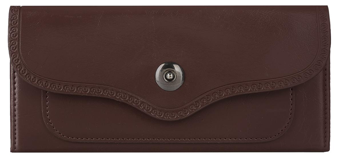 Кошелек женский Leighton, цвет: коричневый. 0005149100051491Стильный женский кошелек Leighton выполнен из искусственной кожи и закрывается фигурным клапаном на магнитную кнопку. Клапан оформлен узором по краю. Подкладка кошелька изготовлена из полиэстера. Изделие содержит три отделения для купюр, два боковых открытых кармана и один открытый карман с пластиковой стенкой, карман на молнии, четыре кармашка для кредитных карт или визиток, небольшой карман на передней стенке под клапаном. Кошелек Leighton станет отличным подарком для человека, ценящего качественные и практичные вещи.