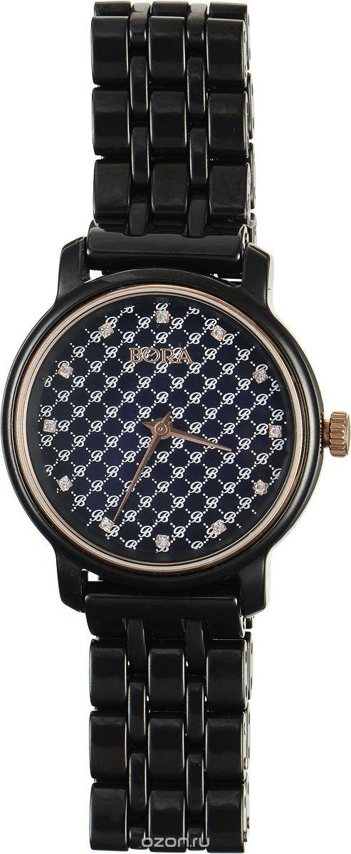 Часы наручные женские Bora, цвет: черный. T-B-8640T-B-8640-WATCH-BLACKЭлегантные женские часы Bora выполнены из керамики и минерального стекла. Перламутровый циферблат дополнен символикой бренда, оформлен контрастным орнаментом и инкрустирован стразами. Корпус часов оснащен кварцевым механизмом со сменным элементом питания, а также дополнен браслетом, который застегивается на застежку-бабочку. Часы поставляются в фирменной упаковке. Часы Bora подчеркнут изящность женской руки и отменное чувство стиля у их обладательницы.