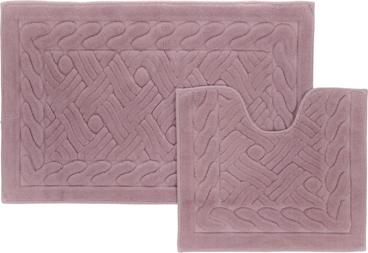 Набор ковриков для ванной Arya Assos, цвет: сухая роза, 2 штTR1001008Сухая РозаНеобыкновенные коврики для ванной Arya Assos обладают эффектным дизайном, мягким и легким в уходе ворсом, нежным естественным оттенком, а также насыщенным цветом. Набор состоит из двух ковриков, выполненных из хлопка и вискозы. Верхняя часть из ворса 4 мм. Коврики украшены рисунком, который придаст еще большей элегантности дизайну ванной комнаты. Особенности изделий: Края ковриков обработаны. Коврики не требовательны в уходе, если они чрезмерно не пачкаются и не загрязняются. В зависимости от интенсивности использования достаточно раз в месяц или в три месяца привести их в порядок. Коврики легко сворачиваются или складываются и помещаются в емкость для стирки. Данные коврики легко выдержат машинную стирку на бережном цикле при 30°С. Хорошо впитывают влагу, быстро сохнут. Коврик - это необходимый предмет, без которого невозможен комфорт и уют в ванной комнате. Размер ковриков: 60 х 100 см, 50 х 60 см.