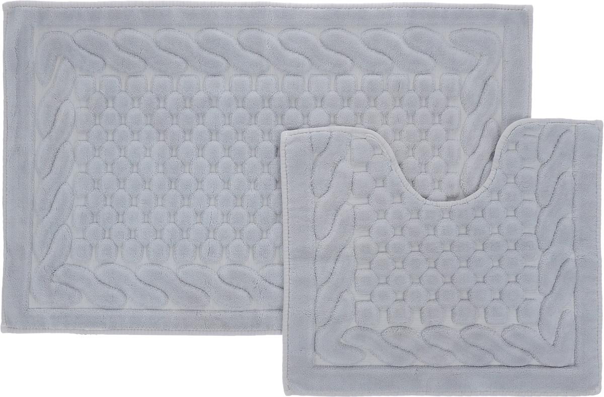 Набор ковриков для ванной Arya Erguvan, цвет: серый, 2 штTR1001006СерыйНеобыкновенные коврики для ванной Arya Erguvan обладают эффектным дизайном, мягким и легким в уходе ворсом, нежным естественным оттенком, а также насыщенным цветом. Набор состоит из двух ковриков, выполненных из хлопка и вискозы. Верхняя часть из ворса 4 мм. Коврики украшены рисунком, который придаст еще большей элегантности дизайну ванной комнаты. Особенности изделий: Края ковриков обработаны. Коврики не требовательны в уходе, если они чрезмерно не пачкаются и не загрязняются. В зависимости от интенсивности использования достаточно раз в месяц или в три месяца привести их в порядок. Коврики легко сворачиваются или складываются и помещаются в емкость для стирки. Данные коврики легко выдержат машинную стирку на бережном цикле при 30°С. Хорошо впитывают влагу, быстро сохнут. Коврик - это необходимый предмет, без которого невозможен комфорт и уют в ванной комнате. Размер ковриков: 60 х 100 см, 50 х 60 см.