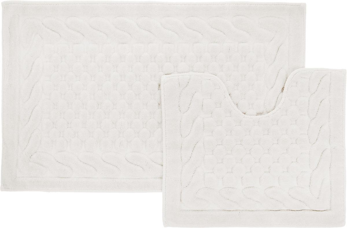 Набор ковриков для ванной Arya Erguvan, цвет: кремовый, 2 штTR1001006КремовыйНеобыкновенные коврики для ванной Arya Erguvan обладают эффектным дизайном, мягким и легким в уходе ворсом, нежным естественным оттенком, а также насыщенным цветом. Набор состоит из двух ковриков, выполненных из хлопка и вискозы. Верхняя часть из ворса 4 мм. Коврики украшены рисунком, который придаст еще большей элегантности дизайну ванной комнаты. Особенности изделий: Края ковриков обработаны. Коврики не требовательны в уходе, если они чрезмерно не пачкаются и не загрязняются. В зависимости от интенсивности использования достаточно раз в месяц или в три месяца привести их в порядок. Коврики легко сворачиваются или складываются и помещаются в емкость для стирки. Данные коврики легко выдержат машинную стирку на бережном цикле при 30°С. Хорошо впитывают влагу, быстро сохнут. Коврик - это необходимый предмет, без которого невозможен комфорт и уют в ванной комнате. Размер ковриков: 60 х 100 см, 50 х 60 см.