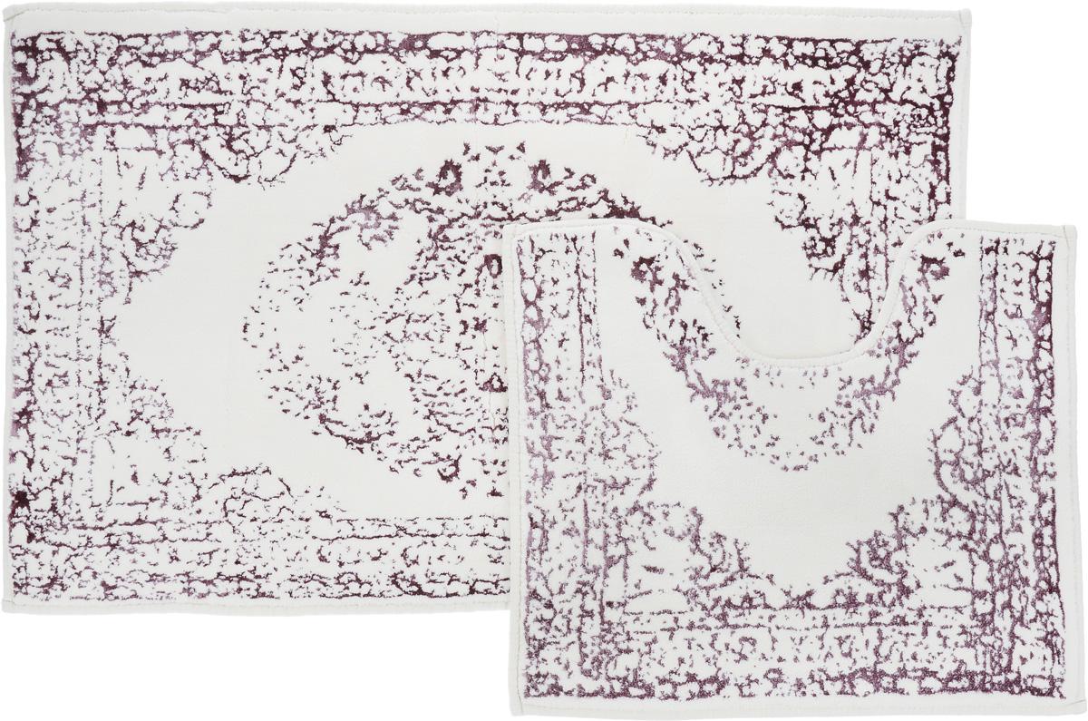 Набор ковриков для ванной Arya Venus, цвет: лиловый, молочный, 2 штTR1001005ЛиловыйНеобыкновенные коврики для ванной Arya Venus обладают эффектным дизайном, мягким и легким в уходе ворсом, нежным естественным оттенком, а также насыщенным цветом. Набор состоит из двух ковриков, выполненных из хлопка и вискозы. Верхняя часть из ворса 4 мм. Коврики украшены рисунком, который придаст еще большей элегантности дизайну ванной комнаты. Особенности изделий: Края ковриков обработаны. Коврики не требовательны в уходе, если они чрезмерно не пачкаются и не загрязняются. В зависимости от интенсивности использования достаточно раз в месяц или в три месяца привести их в порядок. Коврики легко сворачиваются или складываются и помещаются в емкость для стирки. Данные коврики легко выдержат машинную стирку на бережном цикле при 30°С. Хорошо впитывают влагу, быстро сохнут. Коврик - это необходимый предмет, без которого невозможен комфорт и уют в ванной комнате. Размер ковриков: 60 х 100 см, 50 х 60 см.