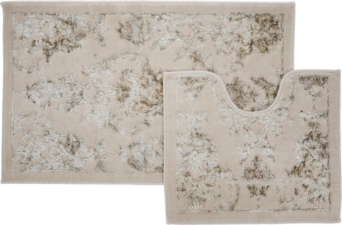 Набор ковриков для ванной Arya Osmanli, цвет: бежевый, белый, 2 штTR1001009БежевыйНеобыкновенные коврики для ванной Arya Osmanli обладают эффектным дизайном, мягким и легким в уходе ворсом, нежным естественным оттенком, а также насыщенным цветом. Набор состоит из двух ковриков, выполненных из хлопка и вискозы. Верхняя часть из ворса 4 мм. Коврики украшены рисунком, который придаст еще большей элегантности дизайну ванной комнаты. Особенности изделий: Края ковриков обработаны. Коврики не требовательны в уходе, если они чрезмерно не пачкаются и не загрязняются. В зависимости от интенсивности использования достаточно раз в месяц или в три месяца привести их в порядок. Коврики легко сворачиваются или складываются и помещаются в емкость для стирки. Данные коврики легко выдержат машинную стирку на бережном цикле при 30°С. Хорошо впитывают влагу, быстро сохнут. Коврик - это необходимый предмет, без которого невозможен комфорт и уют в ванной комнате. Размер ковриков: 60 х 100 см, 50 х 60 см.