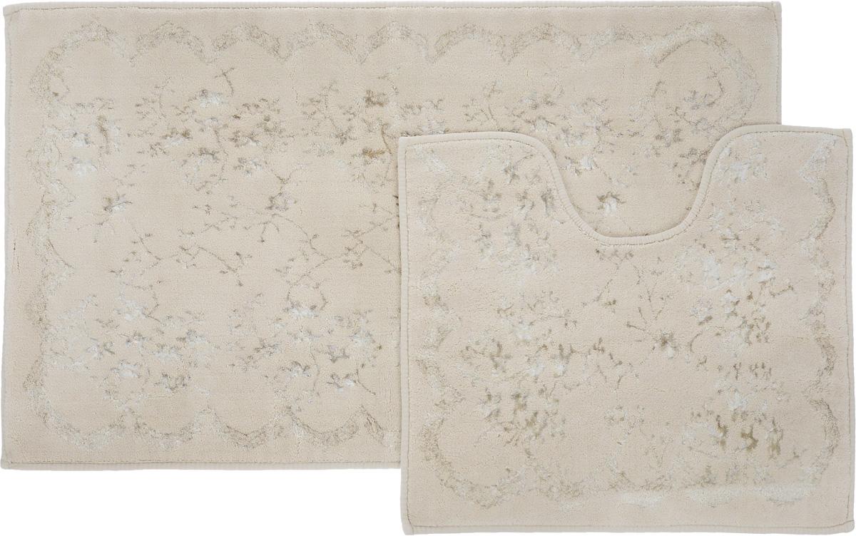 Набор ковриков для ванной Arya Bahar, цвет: темно-бежевый, серый, 2 штTR1001007Темно-БежевыйНеобыкновенные коврики для ванной Arya Bahar обладают эффектным дизайном, мягким и легким в уходе ворсом, нежным естественным оттенком, а также насыщенным цветом. Набор состоит из двух ковриков, выполненных из хлопка и вискозы. Верхняя часть из ворса 4 мм. Коврики украшены рисунком, который придаст еще большей элегантности дизайну ванной комнаты. Особенности изделий: Края ковриков обработаны. Коврики не требовательны в уходе, если они чрезмерно не пачкаются и не загрязняются. В зависимости от интенсивности использования достаточно раз в месяц или в три месяца привести их в порядок. Коврики легко сворачиваются или складываются и помещаются в емкость для стирки. Данные коврики легко выдержат машинную стирку на бережном цикле при 30°С. Хорошо впитывают влагу, быстро сохнут. Коврик - это необходимый предмет, без которого невозможен комфорт и уют в ванной комнате. Размер ковриков: 60 х 100 см, 50 х 60 см.