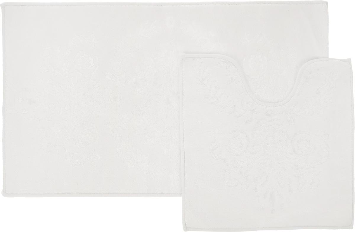 Набор ковриков для ванной Arya Luхor, цвет: кремовый, 2 штF9728760КремовыйНеобыкновенные коврики для ванной Arya Luxor обладают эффектным дизайном, мягким и легким в уходе ворсом, нежным естественным оттенком, а также насыщенным цветом. Набор состоит из двух ковриков, выполненных из хлопка и вискозы. Верхняя часть из ворса 4 мм. Коврики украшены рисунком, который придаст еще большей элегантности дизайну ванной комнаты. Особенности изделий: Края ковриков обработаны. Коврики не требовательны в уходе, если они чрезмерно не пачкаются и не загрязняются. В зависимости от интенсивности использования достаточно раз в месяц или в три месяца привести их в порядок. Коврики легко сворачиваются или складываются и помещаются в емкость для стирки. Данные коврики легко выдержат машинную стирку на бережном цикле при 30°С. Хорошо впитывают влагу, быстро сохнут. Коврик - это необходимый предмет, без которого невозможен комфорт и уют в ванной комнате. Размер ковриков: 60 х 100 см, 50 х 60 см.