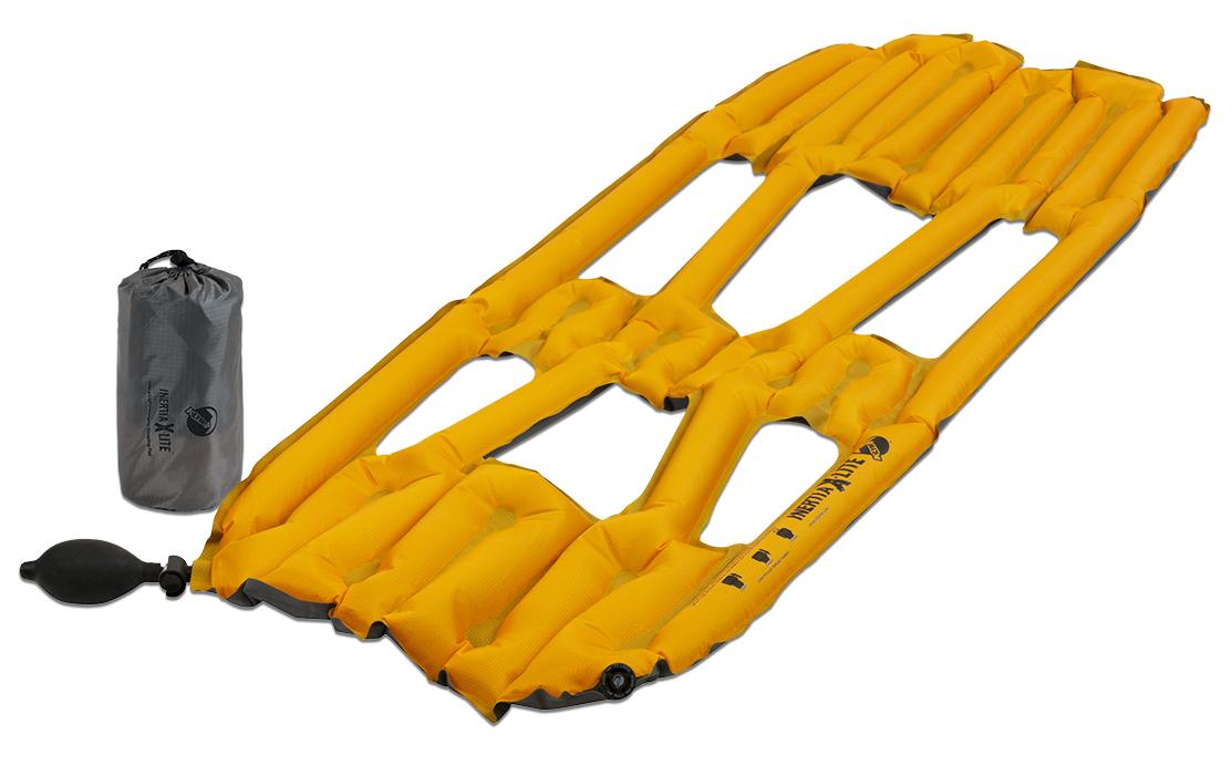 Надувной коврик Klymit Inertia X-Lite pad Orange, цвет: оранжевый06ILOr01ACамый легкий и компактный туристический коврик! 3/4 длины стандартного коврика. Технология loft pocket (сохранение тепла и улучшенная воздухопроницаемость за счет пустот и сварных швов) Технология body mapping (комфорт за счет учета ключевых точек давления тела на коврик) 3- х сезонный - Материал – полиэстер 75D –низ; 30 D- верх - Надувается за 2- 4 выдоха - Размер – 107 см x 46 см x 4 см ; в сложенном виде - 6.4 см x 14 см - Вес – 173 гр. - В комплекте – коврик с 2- мя клапанами (1 для насоса; другой – для спуска во время лежания), насос, набор для ремонта (патч и клей),чехол - Цвет - Оранжевый