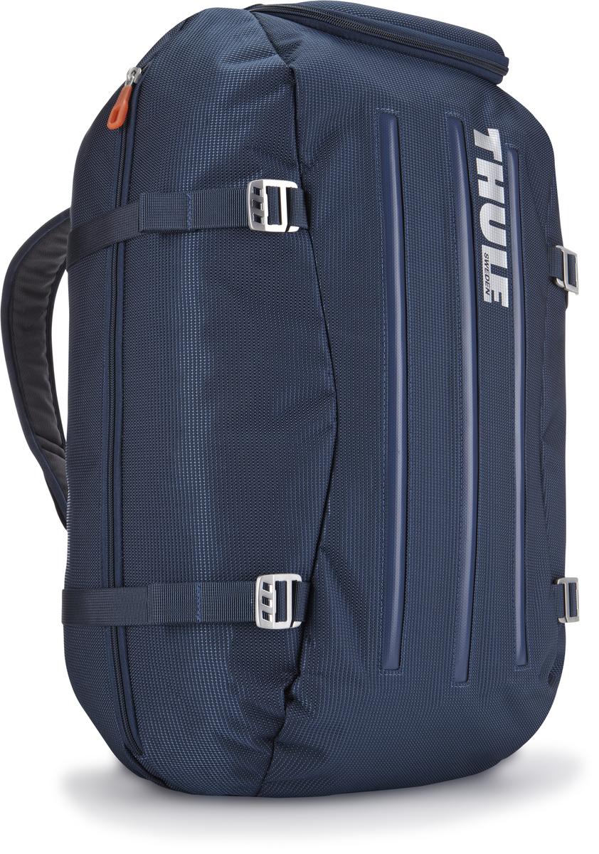 Сумка-рюкзак Thule Crossover Duffel Pack, цвет: темно-синий, 40л. TCDP13201083Туристический рюкзак Thule Crossover 40L - Идеальная сумка для дальних путешествий. Этот гибрид рюкзака и спортивной сумки с молнией сзади обеспечивает сохранность любого содержимого. Алюминиевый каркас и водостойкий материал делают эту сумку легкой, но прочной Изготовленное по технологии горячей прессовки ударопрочное отделение SafeZone защитит ваши очки, портативную электронику и другие хрупкие вещи (отделение запирается и может быть удалено для освобождения дополнительного места). Приподнятые направляющие обеспечивают дополнительную защиту сумки и ее содержимого. Молния на задней стенке позволяет быстро достать из сумки необходимые вещи. Регулировочные ремни для подгонки размера сумки в зависимости от количества багажа Воздухопроницаемые ремни рюкзака Вместительные боковые отделы помогут отделить чистое от грязного, мокрое от сухого и деловое от повседневного.