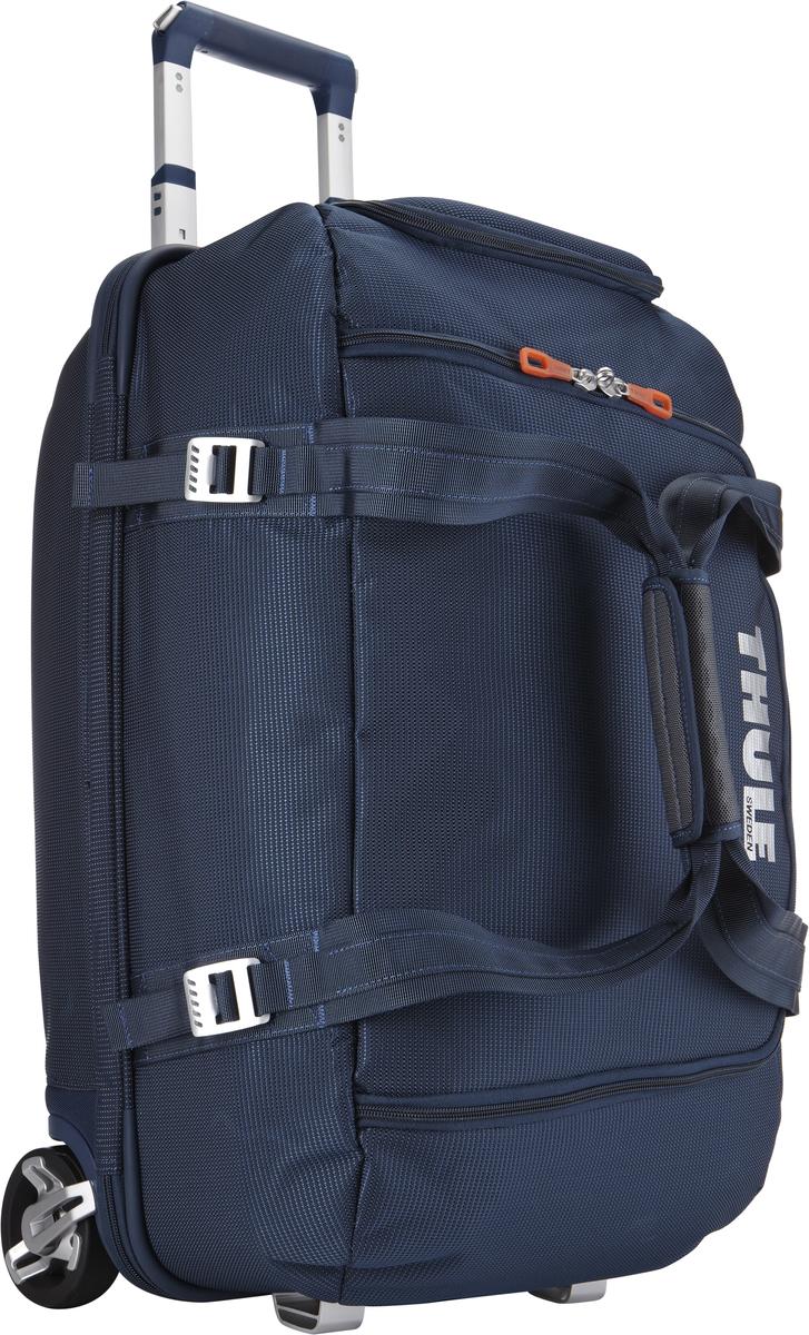 Багажная сумка Thule Crossover Rolling Duffel, на колесах, цвет: темно-синий, 56л. TCRD13201093Дорожная сумка на колесах Thule Crossover 56L - Отличная сумка с широким входом, куда можно с легкостью положить шлем, ботинки, перчатки, куртку и другие туристические принадлежности. Алюминиевый каркас и водостойкий материал делают эту сумку легкой, но прочной Надежный экзоскелет и задняя обшивка из полипропилена обеспечат надежную защиту во время путешествий в самых сложных условиях. Крепкие колеса увеличенного размера и телескопические ручки с технологией Thule V-Tubing гарантируют мягкое, плавное и ровное движение в течение многих лет. Регулировочные ремни для подгонки размера сумки в зависимости от количества багажа Изготовленное по технологии горячей прессовки ударопрочное отделение SafeZone защитит ваши очки, портативную электронику и другие хрупкие вещи (отделение запирается и может быть удалено для освобождения дополнительного места). Главное отделение с отсеками поможет отделить чистое от грязного, мокрое от сухого и деловое от повседневного.