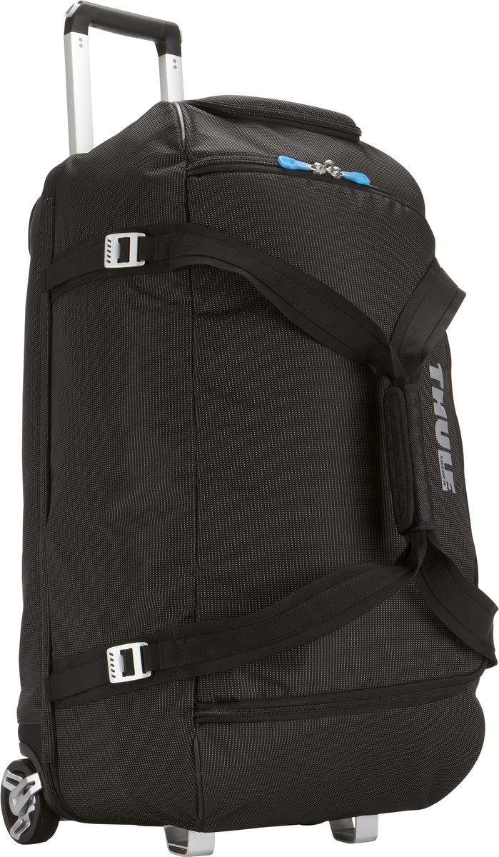 Багажная сумка Thule Crossover Rolling Duffel, на колесах, цвет: черный, 87л. TCRD23201094Дорожная сумка на колесах Thule Crossover 87L - Вместительная сумка с широким входом, куда можно с легкостью положить шлем, ботинки, перчатки, куртку и другие туристические принадлежности. Алюминиевый каркас и водостойкий материал делают эту сумку легкой, но прочной Надежный экзоскелет и задняя обшивка из полипропилена обеспечат надежную защиту во время путешествий в самых сложных условиях. Крепкие колеса увеличенного размера и телескопические ручки с технологией Thule V-Tubing гарантируют мягкое, плавное и ровное движение в течение многих лет. Регулировочные ремни для подгонки размера сумки в зависимости от количества багажа Изготовленное по технологии горячей прессовки ударопрочное отделение SafeZone защитит ваши очки, портативную электронику и другие хрупкие вещи (отделение запирается и может быть удалено для освобождения дополнительного места). Главное отделение с отсеками поможет отделить чистое от грязного, мокрое от сухого и деловое от повседневного. ...