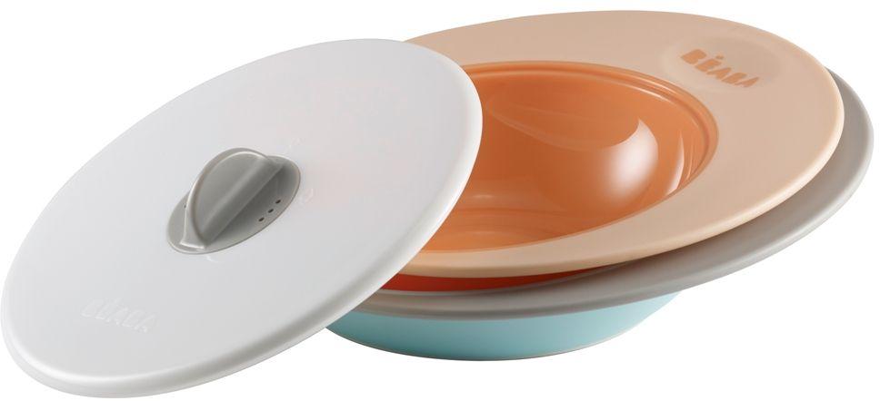 Beaba Набор тарелок для кормления Ellipse цвет персиковый голубой913393Специальная форма тарелок Beaba Ellipse- сохраняет еду ребенка теплой длительное время. Объем тарелок: тарелка - 210 мл, глубокая тарелка - 300 мл. Использование с 6 месяцев. Набор тарелок имеет два положения крышки. Тарелки имеют высокие и широкие края для удобного перемешивания, их выгнутое дно предназначено для естественного распределения пищи по тарелке и удобного захвата ребенком. Тарелки можно использовать в микроволновой печи, они прекрасно сохраняют тепло. Имеют нескользящее основание.