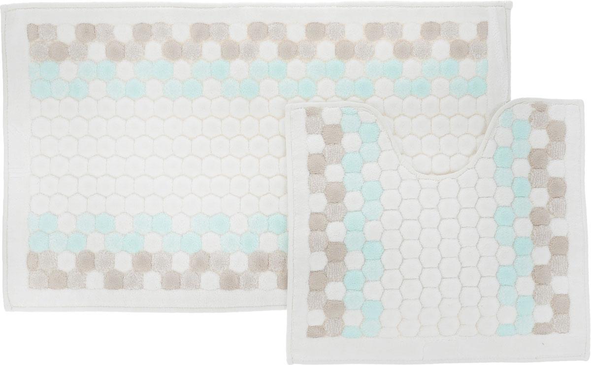 Набор ковриков для ванной Arya Inci, цвет: бирюзовый, молочный, бежевый, 2 штTR1000777БирюзовыйНеобыкновенные коврики для ванной Arya Inci обладают эффектным дизайном, мягким и легким в уходе ворсом, нежным естественным оттенком, а также насыщенным цветом. Набор состоит из двух ковриков, выполненных из хлопка и вискозы. Верхняя часть из ворса 4 мм. Коврики украшены рисунком, который придаст еще большей элегантности дизайну ванной комнаты. Особенности изделий: Края ковриков обработаны. Коврики не требовательны в уходе, если они чрезмерно не пачкаются и не загрязняются. В зависимости от интенсивности использования достаточно раз в месяц или в три месяца привести их в порядок. Коврики легко сворачиваются или складываются и помещаются в емкость для стирки. Данные коврики легко выдержат машинную стирку на бережном цикле при 30°С. Хорошо впитывают влагу, быстро сохнут. Коврик - это необходимый предмет, без которого невозможен комфорт и уют в ванной комнате. Размер ковриков: 60 х 100 см, 50 х 60 см.
