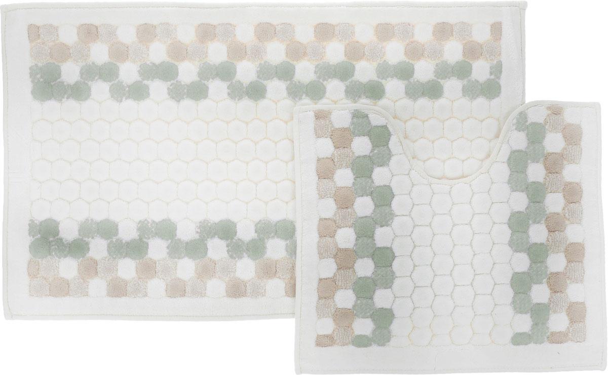 Набор ковриков для ванной Arya Inci, цвет: зеленый, молочный, бежевый, 2 штTR1000777ЗеленыйНеобыкновенные коврики для ванной Arya Inci обладают эффектным дизайном, мягким и легким в уходе ворсом, нежным естественным оттенком, а также насыщенным цветом. Набор состоит из двух ковриков, выполненных из хлопка и вискозы. Верхняя часть из ворса 4 мм. Коврики украшены рисунком, который придаст еще большей элегантности дизайну ванной комнаты. Особенности изделий: Края ковриков обработаны. Коврики не требовательны в уходе, если они чрезмерно не пачкаются и не загрязняются. В зависимости от интенсивности использования достаточно раз в месяц или в три месяца привести их в порядок. Коврики легко сворачиваются или складываются и помещаются в емкость для стирки. Данные коврики легко выдержат машинную стирку на бережном цикле при 30°С. Хорошо впитывают влагу, быстро сохнут. Коврик - это необходимый предмет, без которого невозможен комфорт и уют в ванной комнате. Размер ковриков: 60 х 100 см, 50 х 60 см.