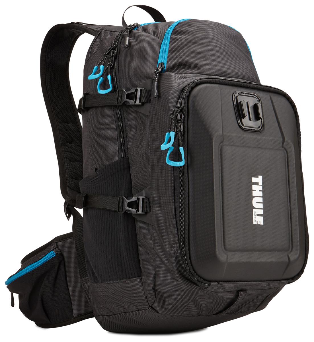 Рюкзак для экшн-камеры Thule Legend GoPro Backpack, цвет: черный3203102Рюкзак Thule Legend GoPro - Тонкий рюкзак для камеры GoPro со встроенными креплениями позволит запечатлеть ваше путешествие с различных ракурсов. Ударопрочный отсек с мягкой подкладкой позволяет хранить до трех камер GoPro, LCD Touch BacPac, пульт дистанционного управления, запасные аккумуляторы и SD-карты Съемная подкладка из прессованной пены облегчает очистку внутренней поверхности от пыли, грязи, песка и пр. Встроенные крепления позволяют установить две камеры GoPro и вести съемку с нескольких ракурсов В жестком кармане можно хранить зарядные устройства и кабели Отдельный отсек для штативов и ремней Благодаря конструкции с обтекаемой формой и малым весом сумка не мешает отдыху Специальное отделение для бутылки с водой (бутылка в комплект не входит) Большие язычки на молниях обеспечивают удобство доступа даже в том случае, если на вас надеты перчатки Поясной и нагрудный ремни обеспечивают комфорт и улучшенную фиксацию Легкодоступные боковые...
