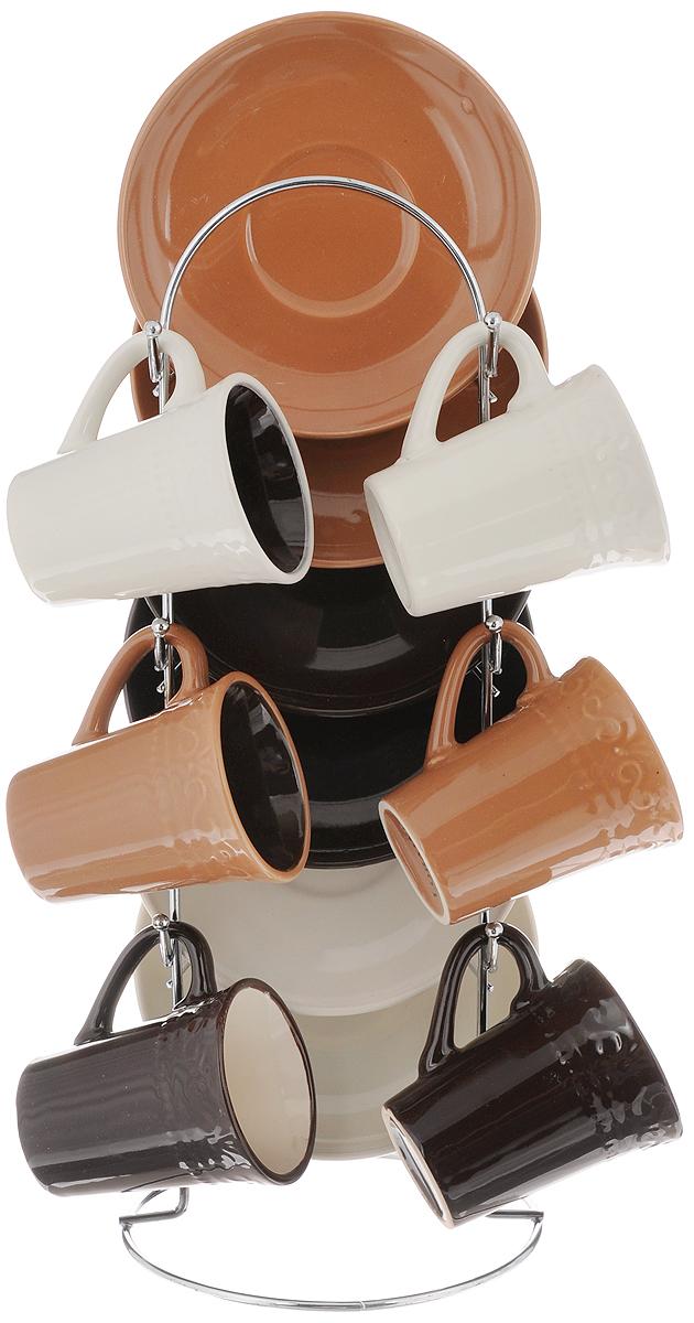 Набор кофейный Loraine, на подставке, 13 предметов. 24676024670Набор Loraine состоит из шести чашек и шести блюдец, изготовленных из высококачественной керамики. Чашки оформлены рельефным узором. Изделия расположены на металлической подставке. Такой набор подходит для подачи свежесваренного кофе. Изящный дизайн придется по вкусу и ценителям классики, и тем, кто предпочитает утонченность и изысканность. Он настроит на позитивный лад и подарит хорошее настроение с самого утра. Можно мыть в посудомоечной машине. Объем чашки: 90 мл. Диаметр чашки (по верхнему краю): 5 см. Высота чашки: 6,8 см. Диаметр блюдца: 11,5 см. Размер подставки: 12 х 12 х 30 см.