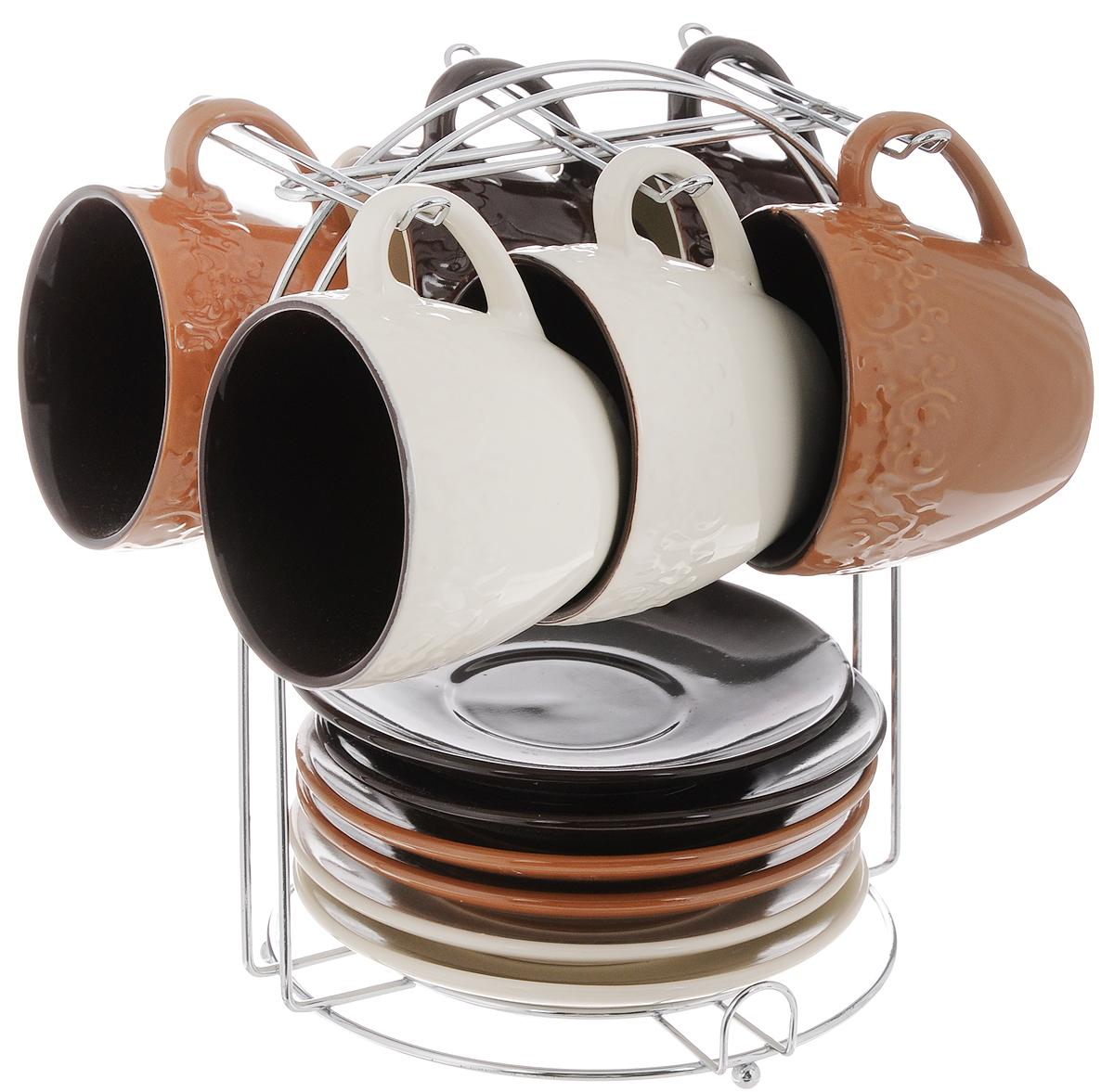 Набор чайный Loraine, на подставке, 13 предметов. 2466424664Набор Loraine состоит из шести чашек и шести блюдец, изготовленных из высококачественной керамики. Чашки оформлены рельефным узором. Изделия расположены на металлической подставке. Такой набор подходит для подачи чая или кофе. Изящный дизайн придется по вкусу и ценителям классики, и тем, кто предпочитает утонченность и изысканность. Он настроит на позитивный лад и подарит хорошее настроение с самого утра. Чайный набор Loraine - идеальный и необходимый подарок для вашего дома и для ваших друзей в праздники. Можно мыть в посудомоечной машине. Объем чашки: 220 мл. Диаметр чашки (по верхнему краю): 8,3 см. Высота чашки: 7,3 см. Диаметр блюдца: 14 см. Размер подставки: 17 х 17 х 22 см.