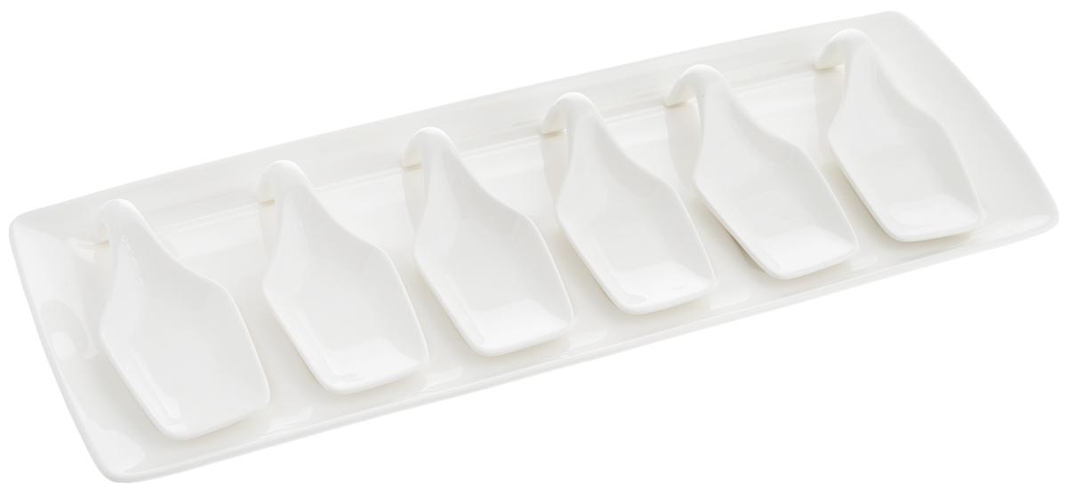 Набор ложек для дегустации Nuova R2S, на подносе, 6 шт93Набор Nuova R2S состоит из 6 ложек специальной формы, предназначенных для подачи и дегустации закусок, снэков, паштетов, десертов. Также в комплект входит поднос. Изделия выполнены из высококачественного фарфора. Подавать закуски на таких мисочках очень красиво - ваши гости попробуют все вкусности, не испачкав пальцы. Можно мыть в посудомоечной машине и использовать в микроволновой печи. Размер подноса: 38 х 14 х 1,5 см. Размер ложки: 11,5 х 5 х 3,3 см.