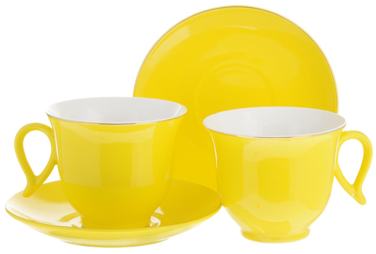 Набор чайный Loraine, цвет: желтый, белый, 4 предмета. 2474624746Набор Loraine выполнен из высококачественного фарфора. Изящный дизайн и красочность оформления придутся по вкусу и ценителям классики, и тем, кто предпочитает утонченность и изысканность. Чайный набор - идеальный и необходимый подарок для вашего дома и для ваших друзей в праздники, юбилеи и торжества! Он также станет отличным корпоративным подарком и украшением любой кухни. Чайный набор упакован в подарочную коробку из плотного цветного картона. Внутренняя часть коробки задрапирована белым атласом. Объем чашки: 220 мл. Диаметр чашки (по верхнему краю): 9,5 см. Высота чашки: 7,5 см. Диаметр блюдца: 14 см. Высота блюдца: 2,5 см.