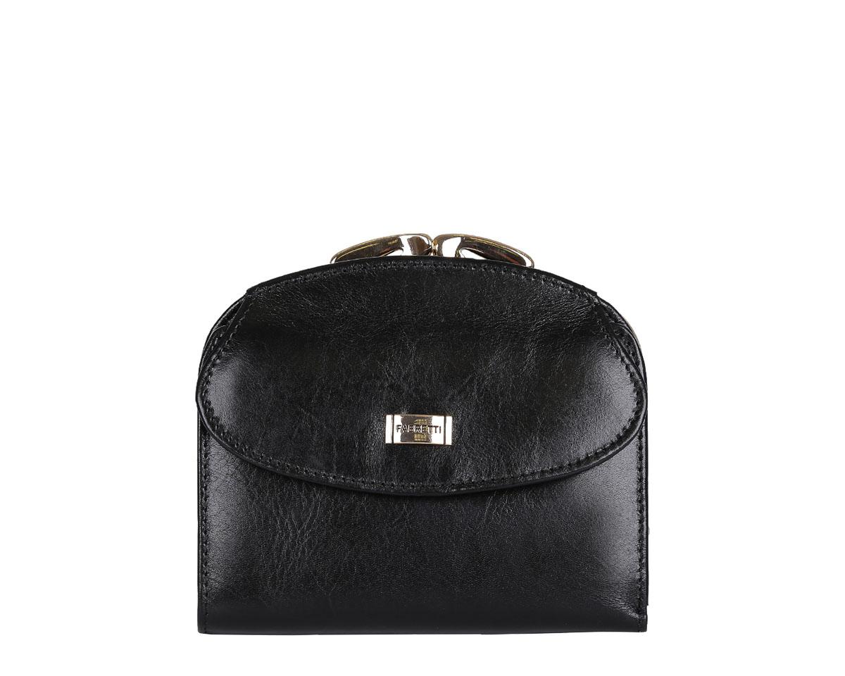 Кошелек женский Fabretti, цвет: черный. FA001FA001-blackУдобный и элегантный женский кошелек от итальянского бренда Fabretti выполнен из натуральной мягкой кожи. Роскошная фурнитура, выполненная в золоте, и классический черный цвет делают дизайн утонченным и изысканным. Внутри имеется одно вместительное отделение для купюр, а также 7 отделений для Ваших кредитных или дисконтных карточек. Вы сможете носить в кошелке свою любимую фотографию за счет удобного прозрачного отдела. На тыльной стороне расположен вместительный карман для мелочи. Он закрывается на изящный рамочный замок, который добавляет в дизайн стиль «ретро».