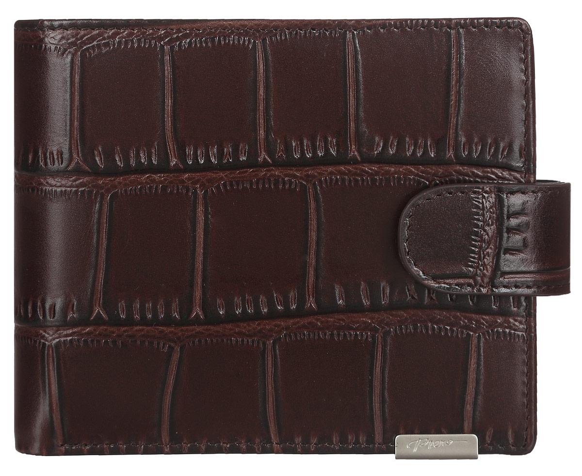Кошелек мужской Piero, цвет: коричневый. МКГ1500820_10МКГ1500820_10Стильный мужской кошелек Piero выполнен из натуральной кожи с глянцевой поверхностью и декоративным теснением под рептилию. Внутри находятся два отделения для купюр, одно из которых закрывается на молнию, карман для мелочи с клапаном на кнопке, три кармашка для визиток и карт, два боковых кармана и металлический держатель для купюр. Изделие закрывается хлястиком на кнопку. Кошелек упакован в фирменную коробку с логотипом бренда. Такой функциональный аксессуар станет замечательным подарком человеку, ценящему качественные и практичные вещи.